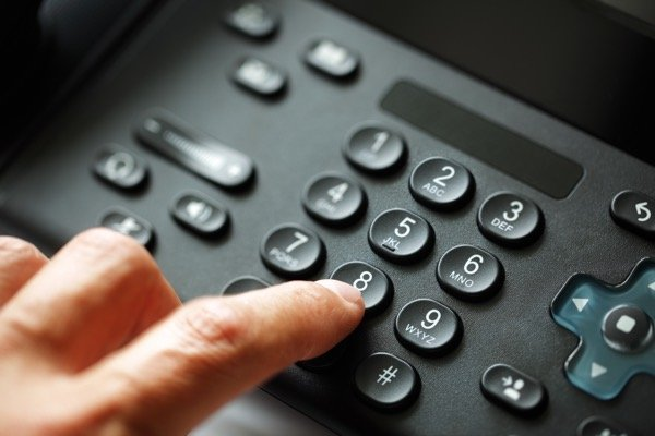 Dial pad on stand alone voice over ip network telephone system