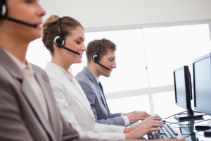 IT consulting experts helping customer via remote support desk